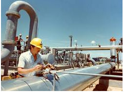 man using an api gage at an oil rig