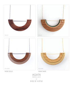 Four picture view showing front and back of necklaces and color options. Necklace design is an open u-shaped hardwood necklace. Rose gold/walnut and sage green/cherry wood.