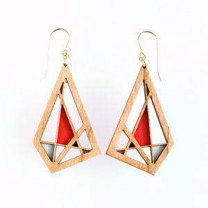 Medium toned cherry wood geometric earrings with gold french hooks with sections painted in metallic gold, bright red and aqua