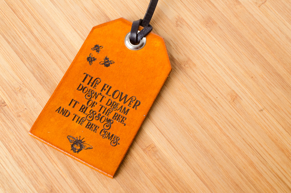 The Flower Doesn't Dream of the Bee it Blossoms and the Bee Comes - Luggage Tag