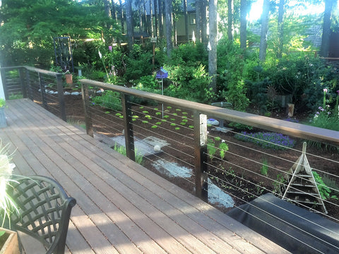 Deck with stainless steel cable railing garden