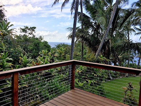 Stainless steel cable railing on deck in Hawaii with ocean view
