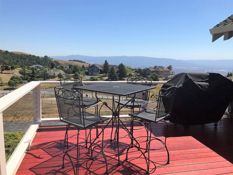 Stainless steel cable deck railing in California with valley view