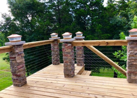 Rock post stainless steel cable railing with wood top rail