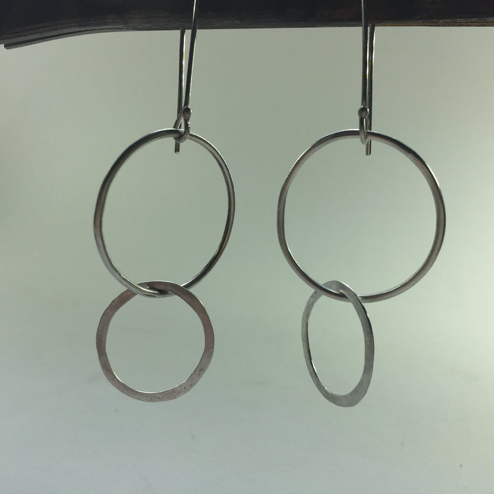 Double circle earrings. Sterling silver. Dangling
