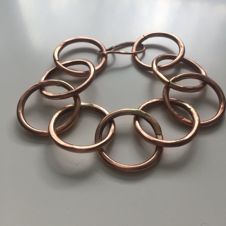 copper bracelet using 1 inch diameter circles. Thick gauge wire. It has some weight to it. A nice weight.