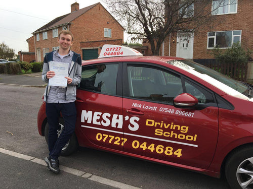 Pupil from Mesh's driving school holding up his pass certificate
