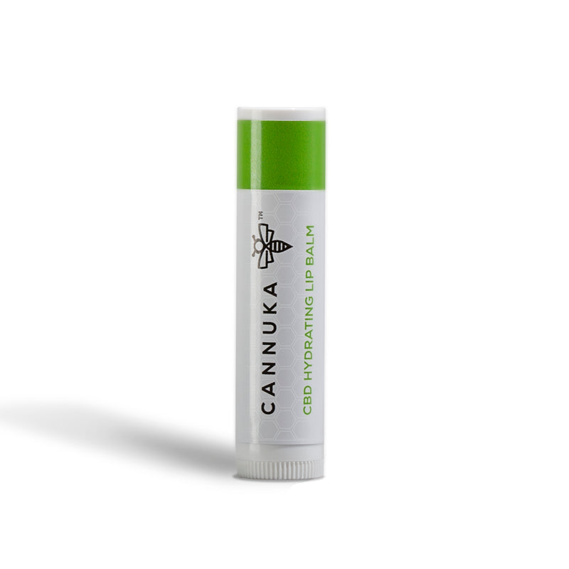 small, white round chapstick tube with green top