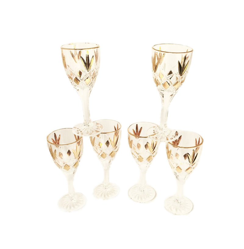 glass host set with six glass crystal glasses and one large glass dispenser with gold detail