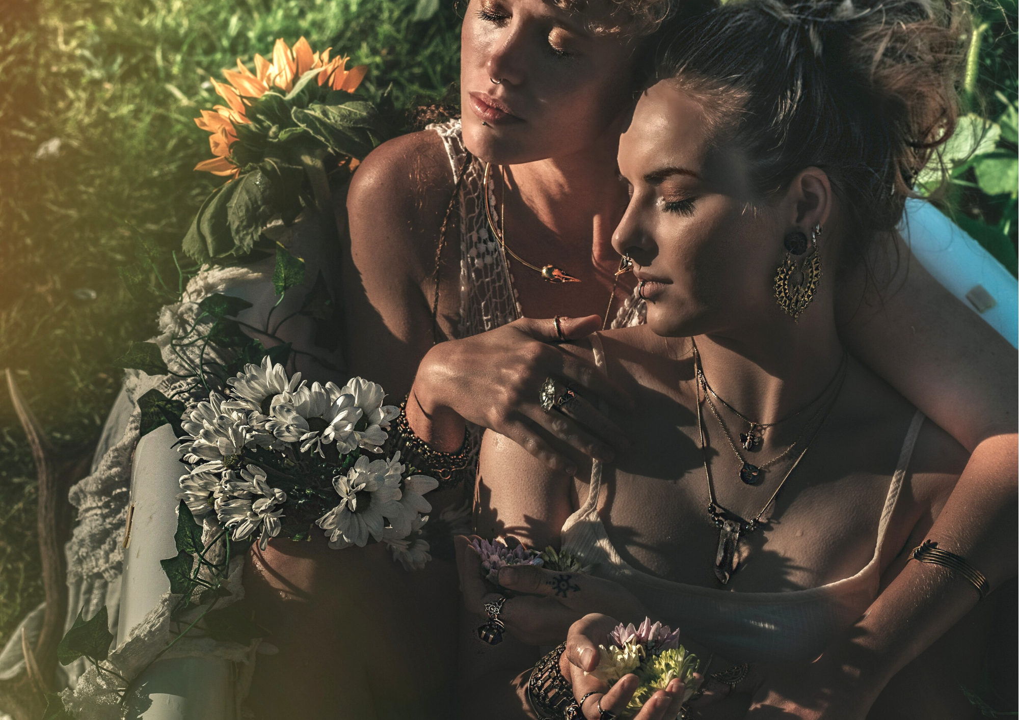 two women in outdoor boho bath with beautiful jewellery, silver rings, bird skull necklace, quartz crystal jewellery, forage design