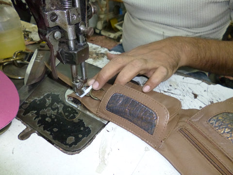 Hand stitching our boho leather money belts and fair trade handbags