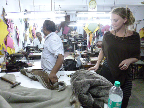 A picture of designer and creator Tina Payne in a fair trade factory creating ethical and sustainable products