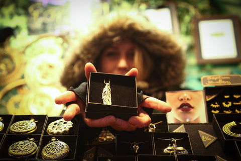Person holding out gift box with ethical jewellery. Forage donate to charity with every purchase of fair trade clothing and  sustainable fashion