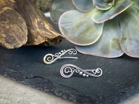 Silver climbing studs on slate with succulents in the background | spiral earrings | silver jewellery | yoga jewellery | charms for well being