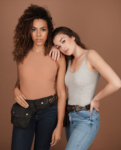 two women wearing boho pocket belts, fair trade handbags , ethical bumbags