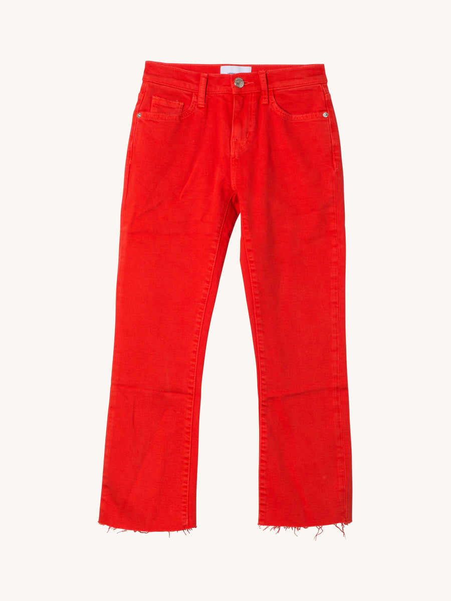 The Kick Jean in Firey Red with Cut Hem