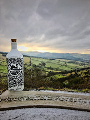 Bottle of Forest Gin and a view of Macclesfield Forest