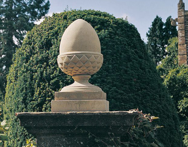 pineapple finial example sitting on top of corner post for illustrated glossary of classical architectural terms from brockwell incorporated