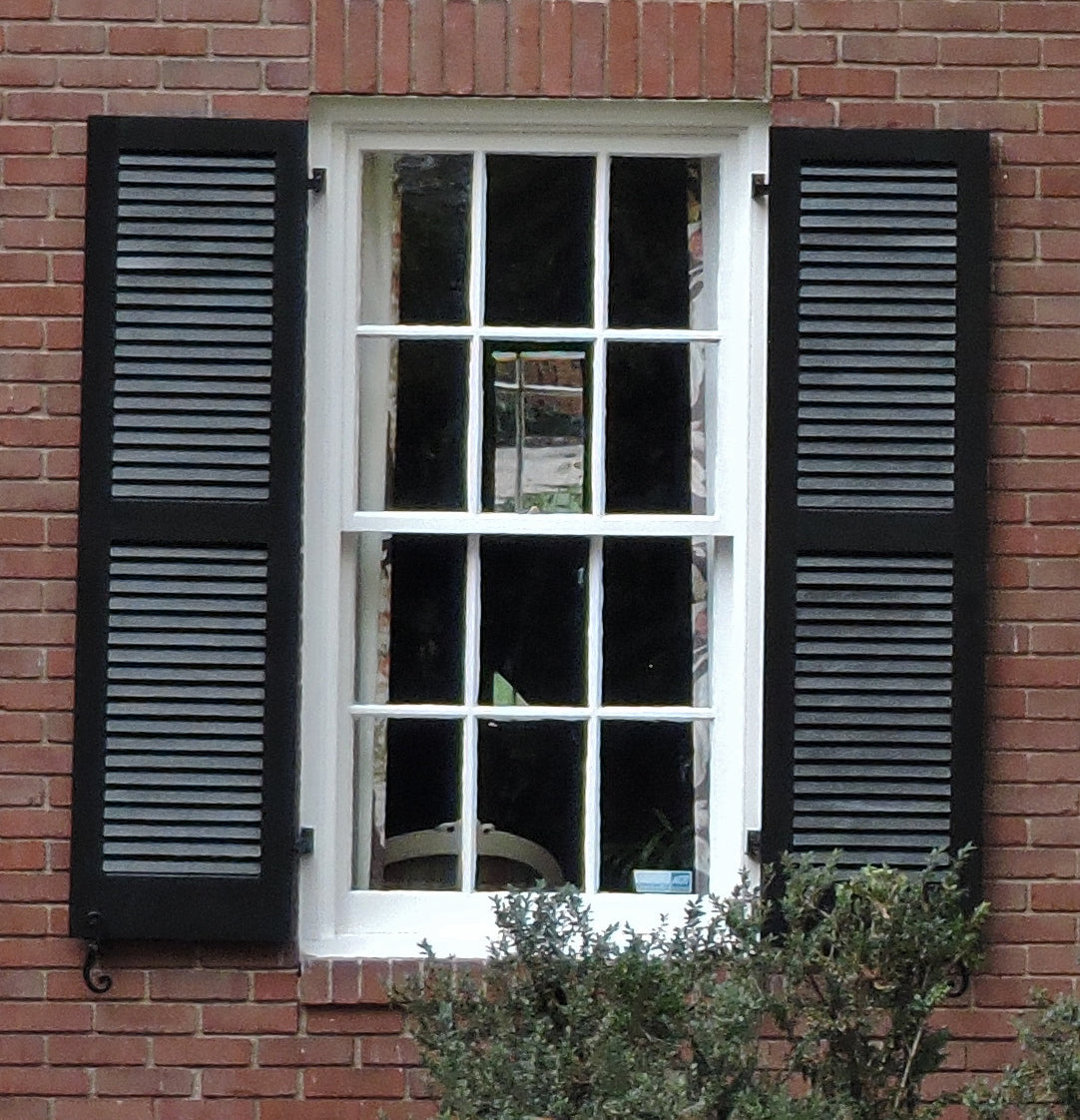 black louvered exterior window shutters on a brick house for brockwell incorporated's illustrated glossary of classical architectural terms