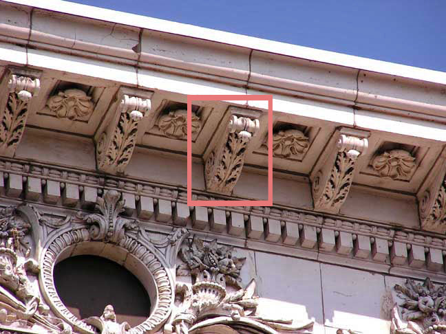 classical modillion example underneath an entablature