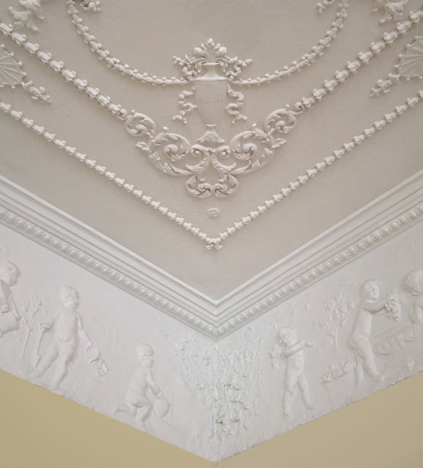 decorative plaster molding on a yellow-painted wall - brockwell incporated