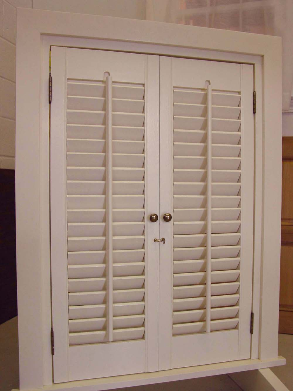 vertical mullion on interior white functional plantation style shutters