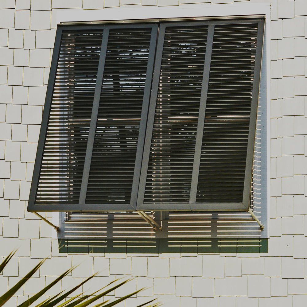 example of a pair of exterior bahama window shutters from brockwell incorporated