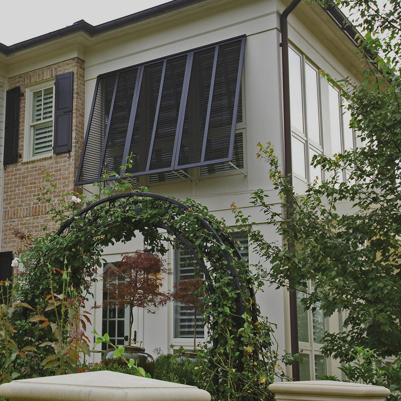 exterior of a home with beautiful dark bahama shutters from brockwell incorporated
