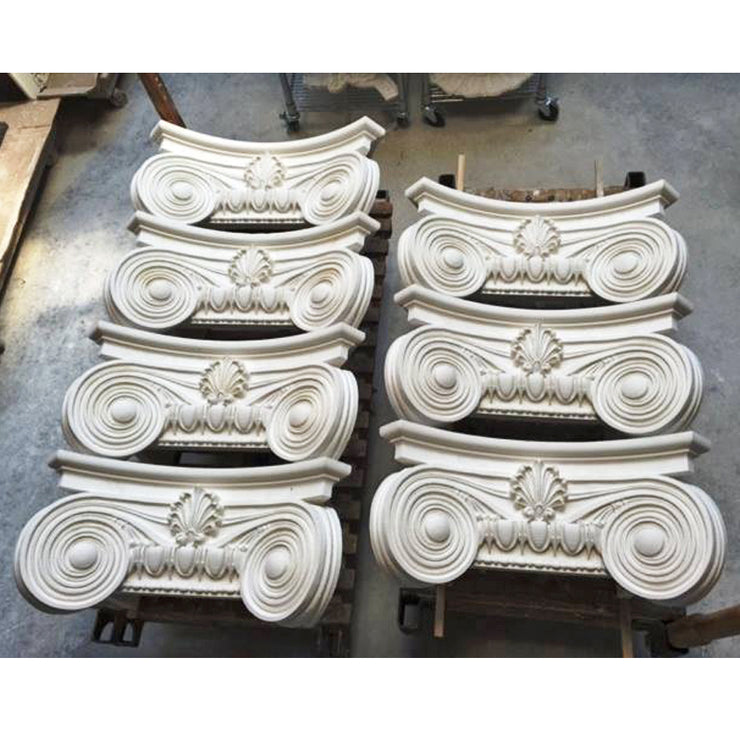 A batch of plaster Modern Empire plaster pilaster capitals ready to be packaged