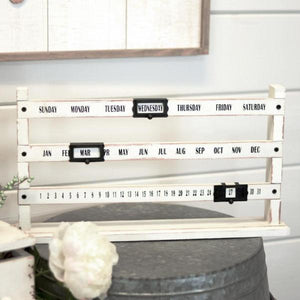 white wooden sliding calendar