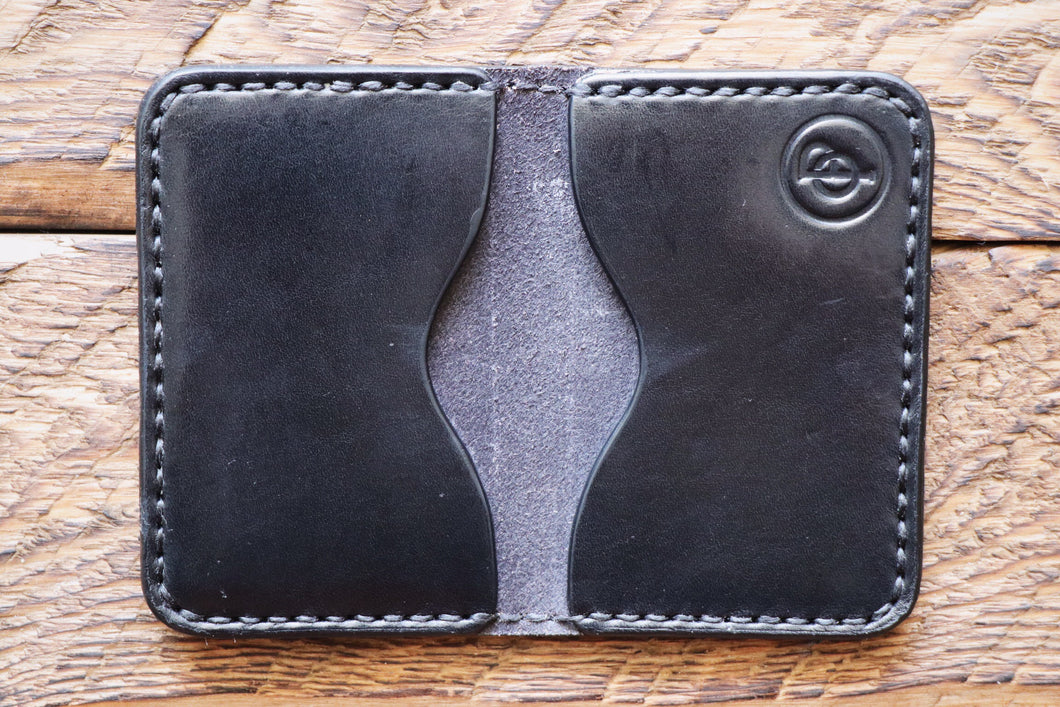 Black handmade and hand stitched leather bifold wallet