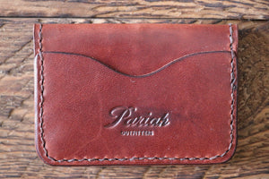 Brown handmade and hand stitched leather bifold wallet
