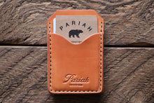 Russet handmade and hand stitched money clip wallet on wood