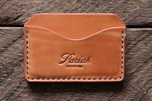Russet handmade and hand stitched horizontal card case wallet on wood