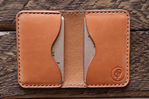 Russet handmade and hand stitched leather bifold wallet