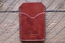 Brown handmade and hand stitched money clip wallet on wood