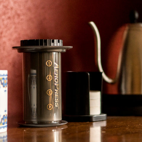 Aero Press Coffee Maker tilted from Filter - Lifestyle Image