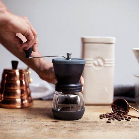 Hario skerton ceramic coffee mill hand grinding - lifestyle image