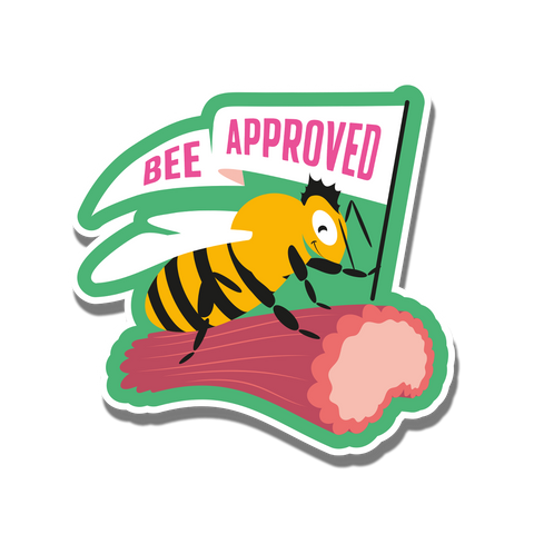 A bee riding on a rhubarb holding a flag with the words 'Bee Approved' on it.