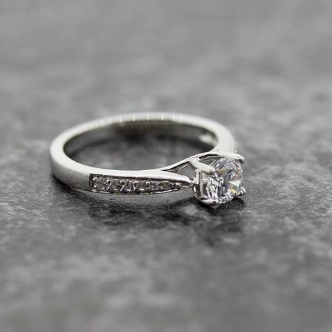 Ladies lab diamond solitaire ring with accented diamond shoulders