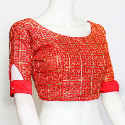 Designer silk saree blouse with boat neck andgold embroidery all over