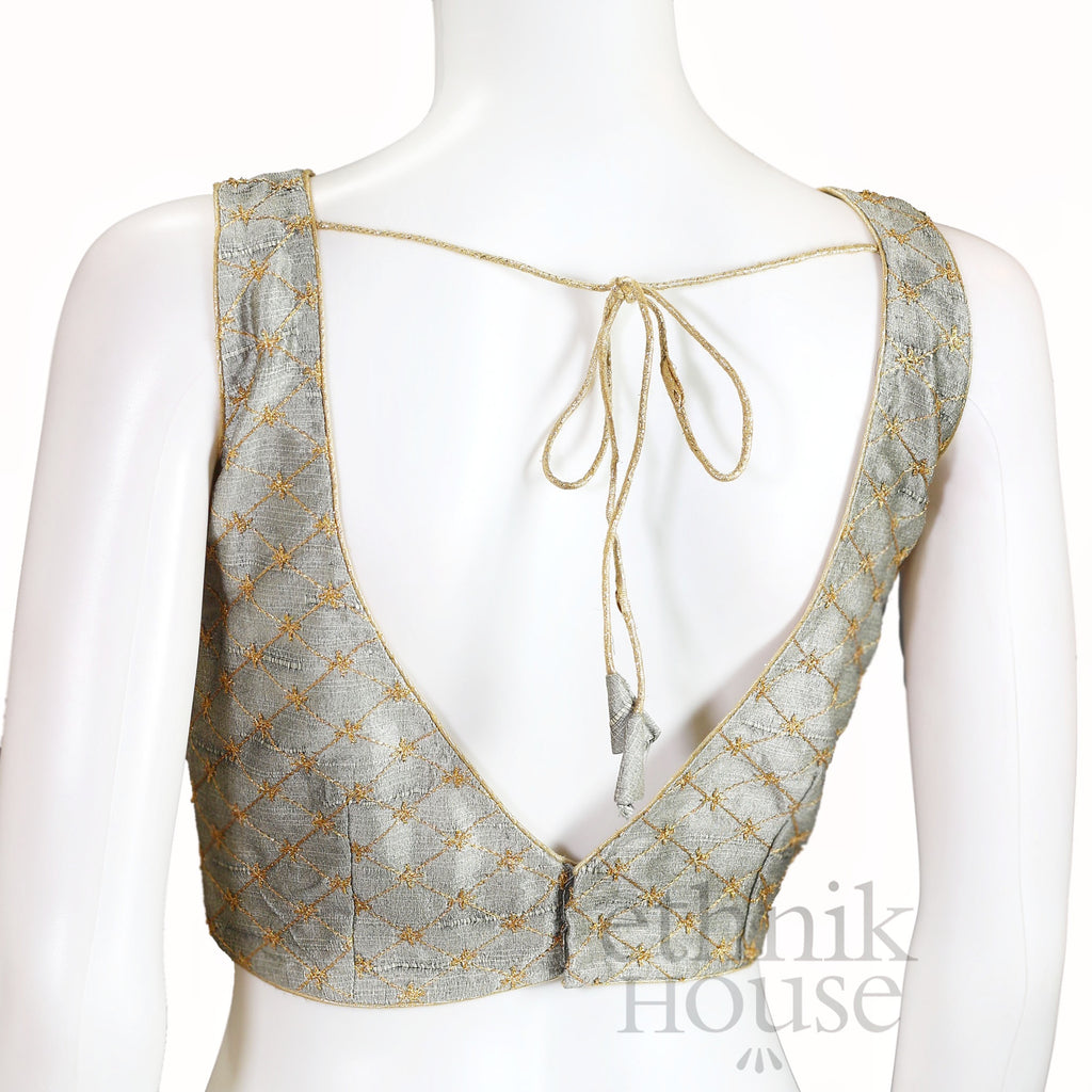 Embroidered readymade sleeveless blouse with V neck