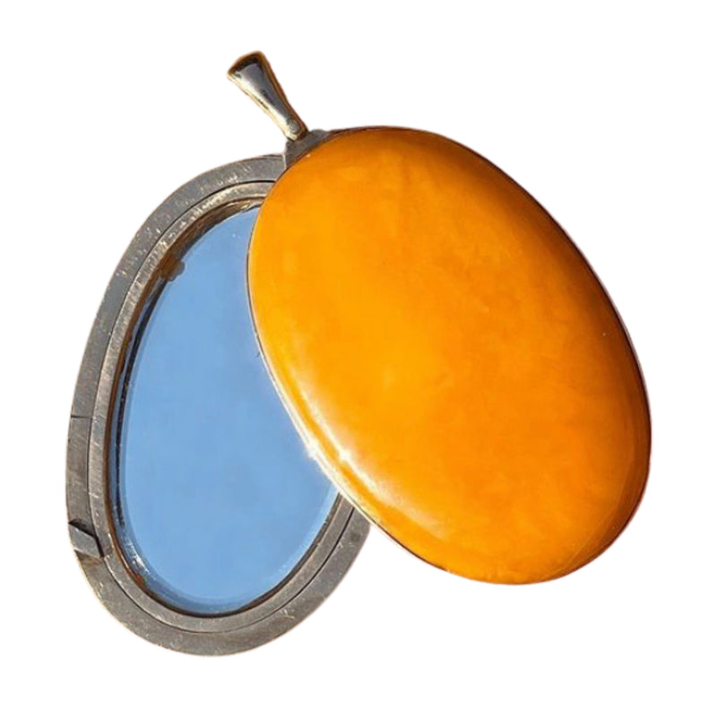 A Large Amber Mirror Locket