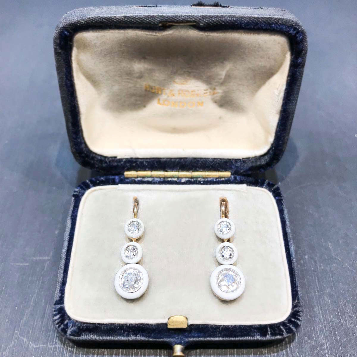 White enamel, 18ct gold, mine cut diamond, drop earrings c.1920s