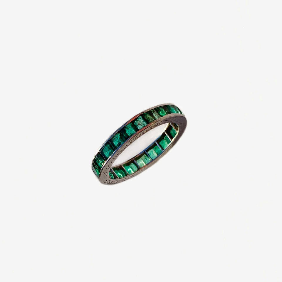 Edwardian emerald eternity ring set in handcrafted platinum