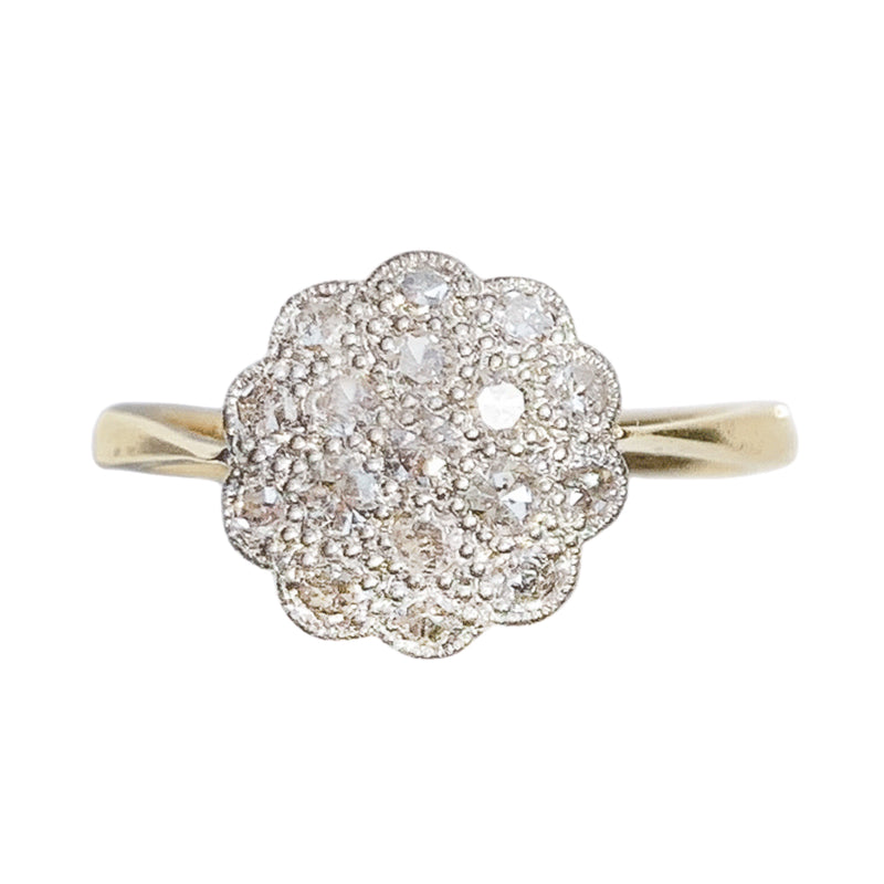 An antique Diamond Daisy Ring by Cropp and Farr