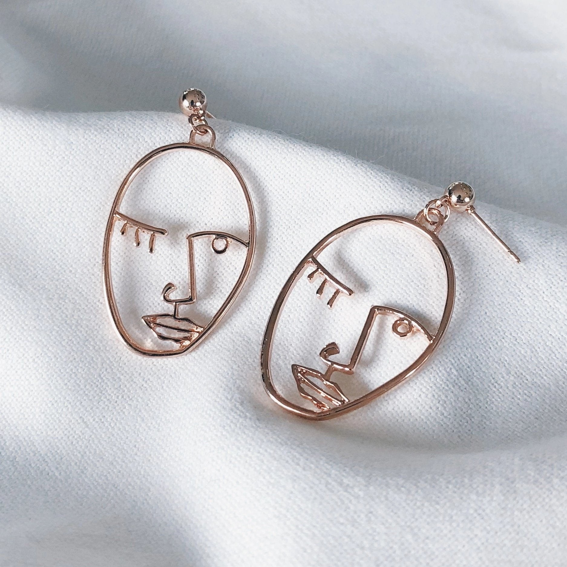 nascul wink gold or rose gold earrings as part of nascul's special earring giveaway promo