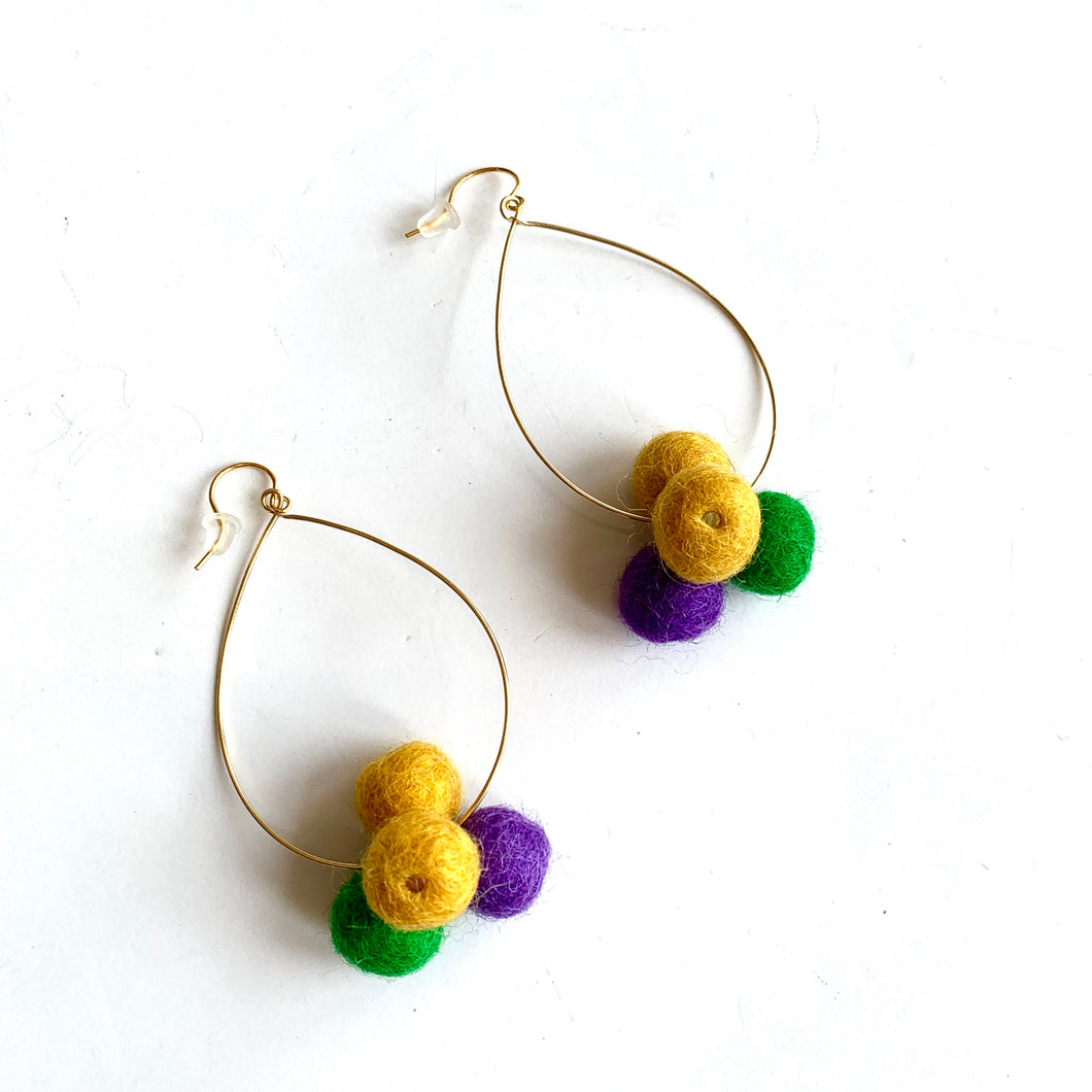 Oval Hoop Pom Pom Earrings