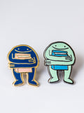 Book Hugger Enamel Pin by Eric Rosario