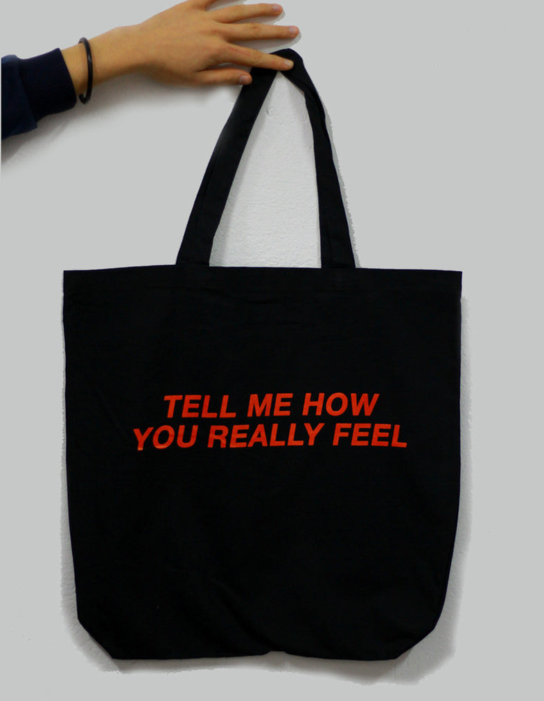 Courtney Barnett Tell Me How You Really Feel design on a black heavweight canvas Totebag from Bingo Merch